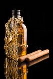 Cigars and whisky bottle Stock Images