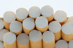Cigatettes in box. Cigarettes with filter on white background Royalty Free Stock Image