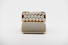 Cigatettes in box. Cigarettes in box on white background Stock Images