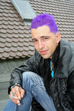 Ciggy. Young punk with purple hair with cigarette Stock Photography
