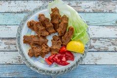 Cigkofte turkish meatball from bulgur with tomato, lemon, and le Stock Photos