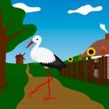 Cigogne près de la maison blanche avec la barrière Photo libre de droits