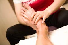 Cihinese foot acupuncture massage Stock Image
