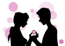Cijfers die een condoom houden Royalty-vrije Stock Afbeelding
