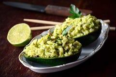 Cilantro lime rice served in avocado halves royalty free stock photo