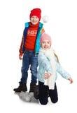 Cildren jouant dans la neige Photo libre de droits