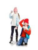 Cildren jouant dans la neige Image libre de droits