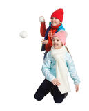 Cildren playing in the snow. Isolated on white background. Children in winter. Happy kids playing snowball stock image