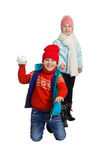 Cildren playing in the snow. Isolated on white background. Children in winter. Happy kids playing snowball stock photos