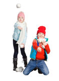 Cildren playing in the snow. Isolated on white background. Children in winter. Happy kids playing snowball royalty free stock photos