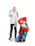 Cildren playing in the snow. Isolated on white background. Children in winter. Happy kids playing snowball royalty free stock image