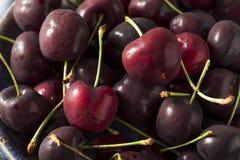 Ciliege organiche rosse crude fotografie stock