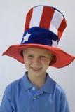 Cilindro d'uso di stelle e strisce del ragazzo Fotografie Stock Libere da Diritti