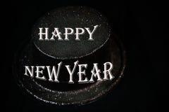 Cilindro en el fondo negro, ` s Eve del Año Nuevo Imagen de archivo libre de regalías