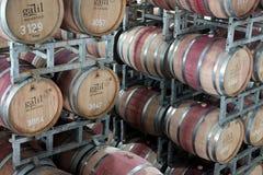 Cilindros do vinho no armazém Fotos de Stock Royalty Free