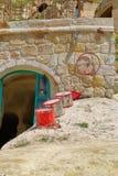 Cilindros na frente da moradia de caverna fotografia de stock