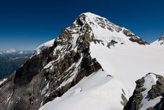 Cima de la montaña de Mönch. Foto de archivo