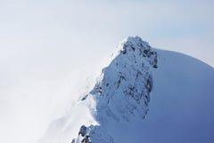 Cima delle alpi Immagine Stock