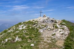 Cima delle Pozzette, A cross on the top of a mountain, turistic train Alta Via del Monte Baldo stock photos
