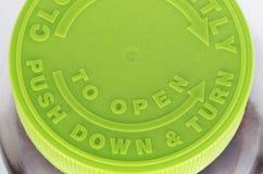 Cima verde della bottiglia di pillola Fotografie Stock