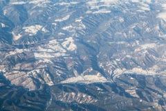Cime della montagna di Snowy Immagine Stock