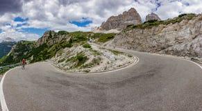 3 cime di Lavaredo u-shape curve with cyclist Royalty Free Stock Photo