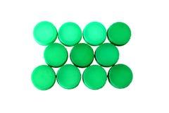 Cime di plastica verdi della bottiglia Fotografia Stock Libera da Diritti