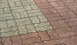 Ciment modelé de passage couvert de brique Image stock