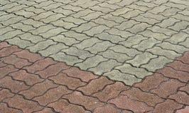 Ciment modelé de passage couvert de brique Images stock