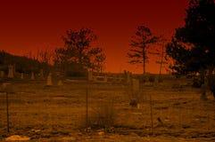 Cimitero nel rosso a penombra Immagine Stock Libera da Diritti