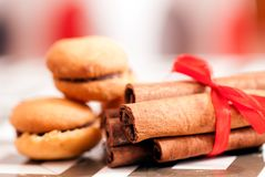 Cinamon and cookies on wooden background royalty free stock photo