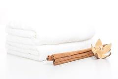 Cinamon sticks and towel Stock Photos