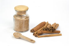 Cinamon sugar with cinamon sticks isolated on white Stock Photos