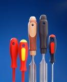 Cinceles y destornilladores en una fila Imagen de archivo libre de regalías