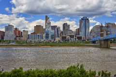 Cincinnati, Ohio Skyline. View of the downtown Cincinnati, Ohio skyline and John Roebling Suspension Bridge from across the Ohio River in Covington, Kentucky royalty free stock photography