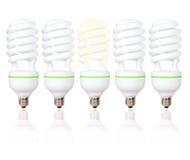 Cinco bombillas ahorros de energía con las Líneas Verdes Imágenes de archivo libres de regalías