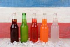 Cinco botellas de soda Fotos de archivo libres de regalías