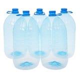 Cinco botellas grandes de agua (trayectoria de recortes) Foto de archivo