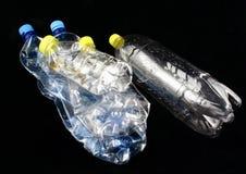 Cinco botellas plásticas Imágenes de archivo libres de regalías