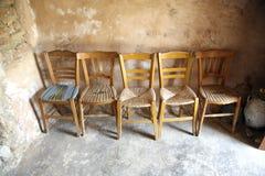 Cinco cadeiras imagens de stock