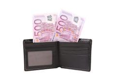 Cinco cem contas do euro na carteira aberta. Foto de Stock