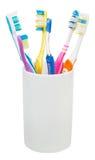 Cinco cepillos de dientes y cepillo interdental Imagen de archivo libre de regalías