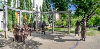 Cinco cinco estatua famosa, Calgary Foto de archivo libre de regalías