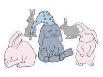 Cinco coelhos pequenos do sono nas cores pastel Imagens de Stock