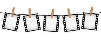 Cinco corrediças de filme da foto em uma corda com clothepins fotografia de stock