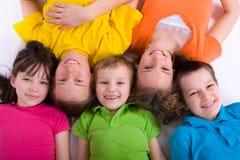 Cinco crianças felizes Imagens de Stock Royalty Free