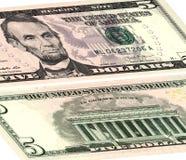 Cinco dólares de E.E.U.U. El frente y el dorso fotos de archivo
