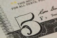 Cinco dólares de fundo do macro Fotografia de Stock Royalty Free