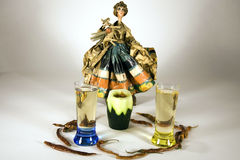 Cinco de Mayo. Fiesta scene with doll of Mexican woman in traditional dress, mexican chiliis and tequila shots with a sangrita chaser stock photography