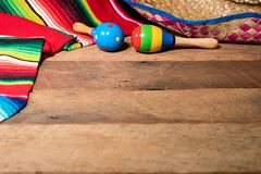 Cinco de Mayo background on wooden boards. Cinco de Mayo background image on with maracas and sombrero on wooden rustic boards Stock Photo
